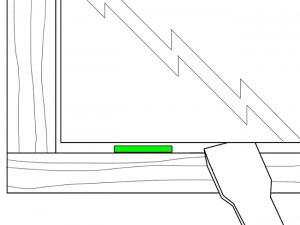 Hochheben der Glasscheibe mittels Verglasungsklotzkelle