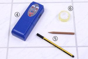 Stifte, durchsichtiges Klebeband und Multifunktionsdetektor