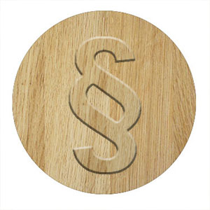 Paragraphenzeichen auf Holz